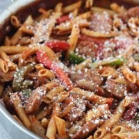 This skillet Italian sausage and peppers with whole-wheat penne is the perfect home cooked meal and it's all in one pot which makes clean up a breeze!