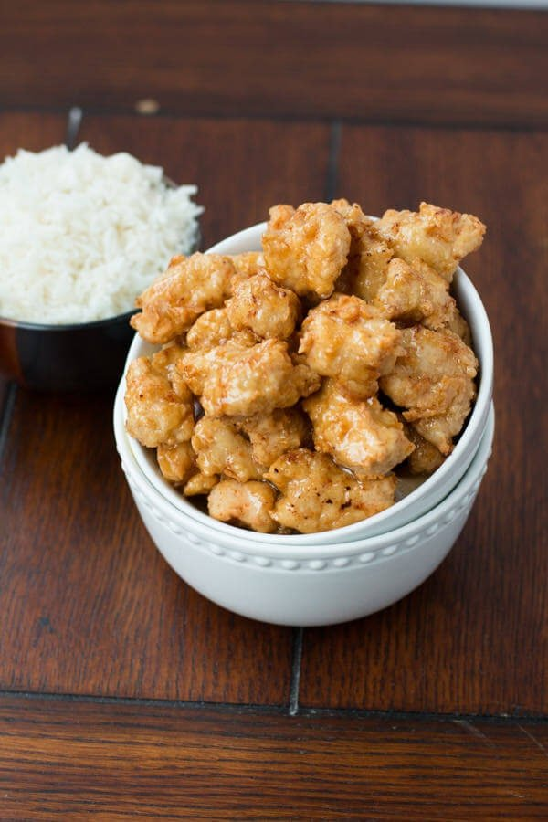 perfectly crunchy, sticky, sweet and saucy honey chicken ohsweetbasil.com
