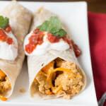 mexican scrambled eggs breakfast burrito and it has a secretly nutritious ingredient-ohsweetbasil.com cheddar, tortilla, sour cream, salsa, egg, butternut squash veggie blend-in, vegetarian