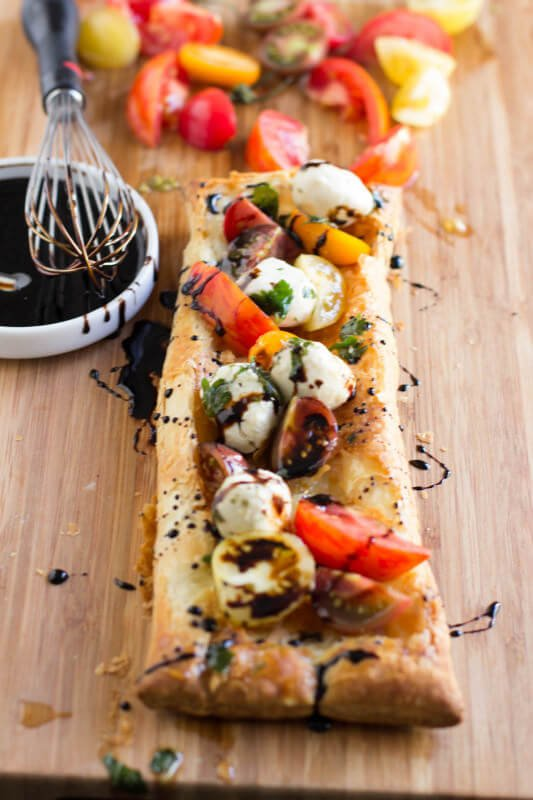 Heriloom-tomatoes-puff-pastry-marinated-mozzarella-and-balsamic-reduction-and-guess-what-all-of-it-is-premade-and-you-can-whip-it-all-together.-ohsweetbasil.com_-4-533x800