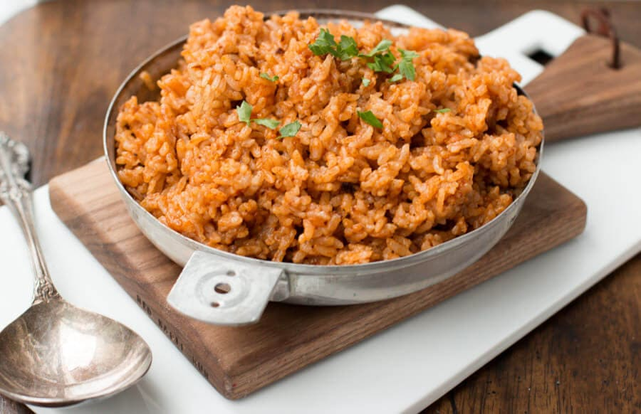 Hooray for a quick and easy 3 ingredient spanish rice that still tastes like your local Mexican restaurant! ohsweetbasil.com