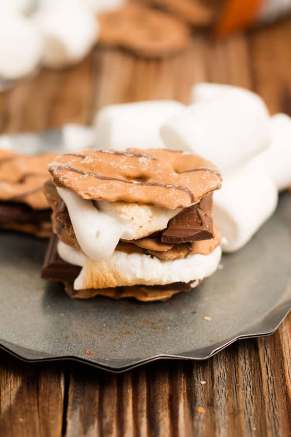 The BEST s'more I've ever had. Peanut butter pretzel crisps instead of grahams! ohsweetbasil.com chocolate, summer, camping dessert, camp food, marshmallow