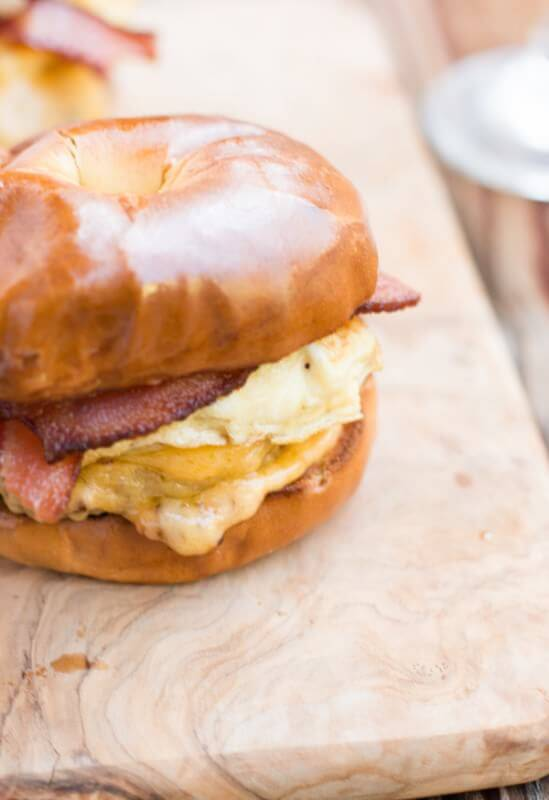 our favorite breakfast sandwich and the secret is in the bread ohsweetbasil.com bacon, cheddar, eggs, bagel, sausage, english muffin, to-go breakfast, quick breakfast