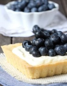 Blueberry Mascarpone Tart -Fresh blueberries and mascarpone filling sits on top of a lemon cookie crust!