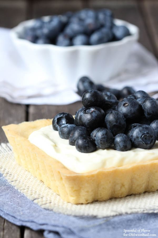 Blueberry Mascarpone Tart - Fresh blueberries and mascarpone filling sits on top of a lemon cookie crust! The perfect dessert!