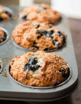 Whole wheat muffins with oat flour and no eggs but are huge and fluffy still! ohsweetbasil.com eggless, egg free