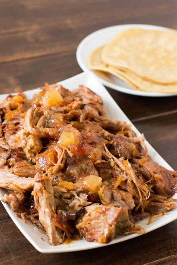 Holy Amazing pineapple habanero pork! 3 ingredients and a slow cooker! ohsweetbasil.com
