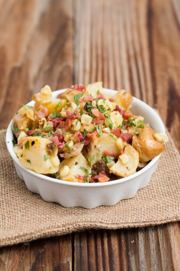 The most delicious German potato salad with corn, bacon, and the best dressing ever ohsweetbasil.com