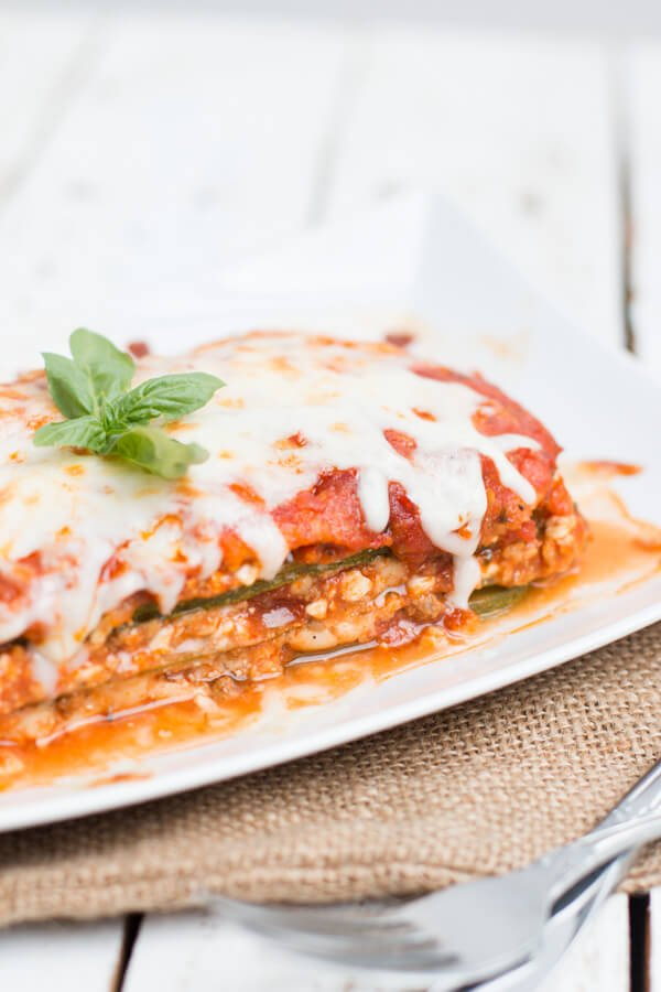 low carb zucchini lasagna on white plate next to fork