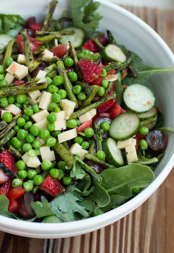 The BEST salad with pomegranate raspberry dressing and lemon brown sugar almonds ohsweetbasil.com