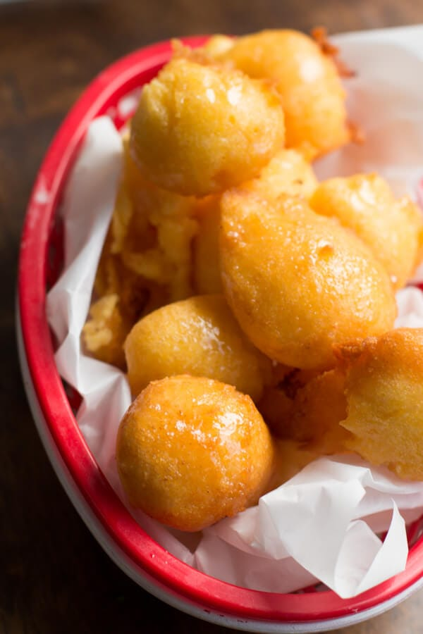 honey butter drenched corn fritters that are fried to a crisp perfection ohsweetbasil.com