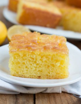 Slice of Lemon Jello Cake on a white plate.