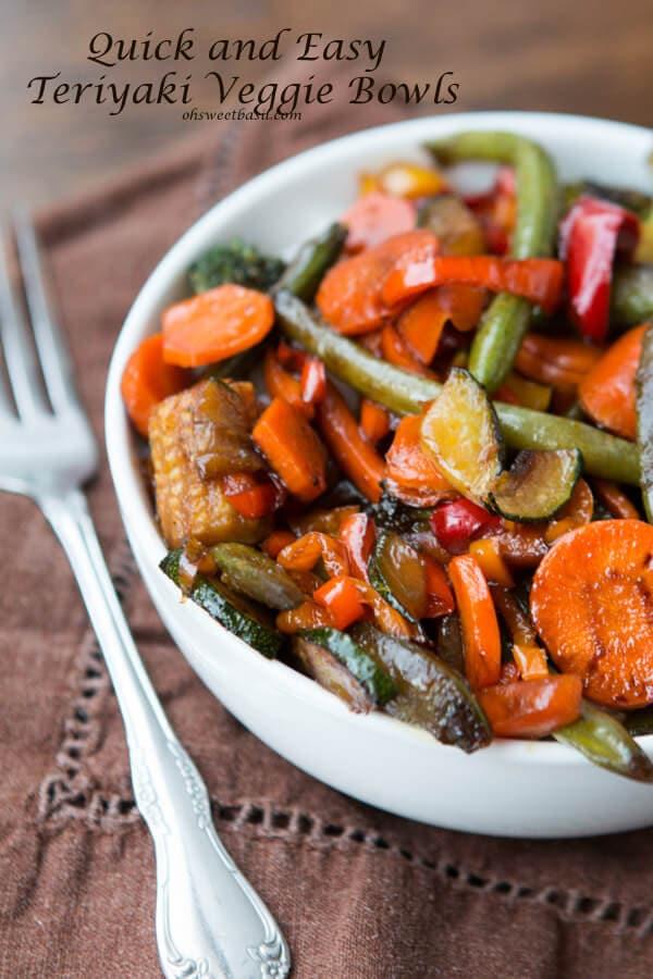 teriyaki vegetables in white bowl next to fork