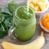 This Pineapple Orange Banana Green Smoothie is fruity and refreshing with chia seeds and spinach to add fiber and protein for additional nutrition! From Dessert Now Dinner Later for OhSweetBasil.com