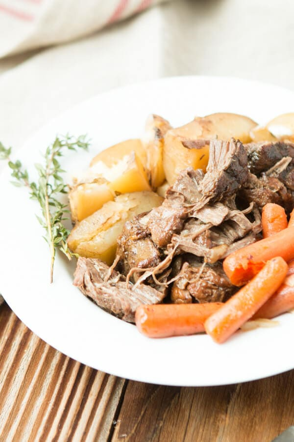 The easiest and best slow cooker pot roast with potatoes and carrots ohsweetbasil.com insta pot, crock pot, pressure cooker