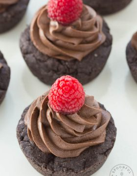 Double Dark Chocolate Cookie Cups - rich chocolate cups are topped with dark chocolate frosting to create an irresistible treat!