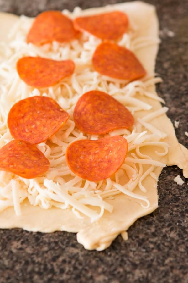 Deep fried pepperoni pizza puffs ohsweetbasil.com
