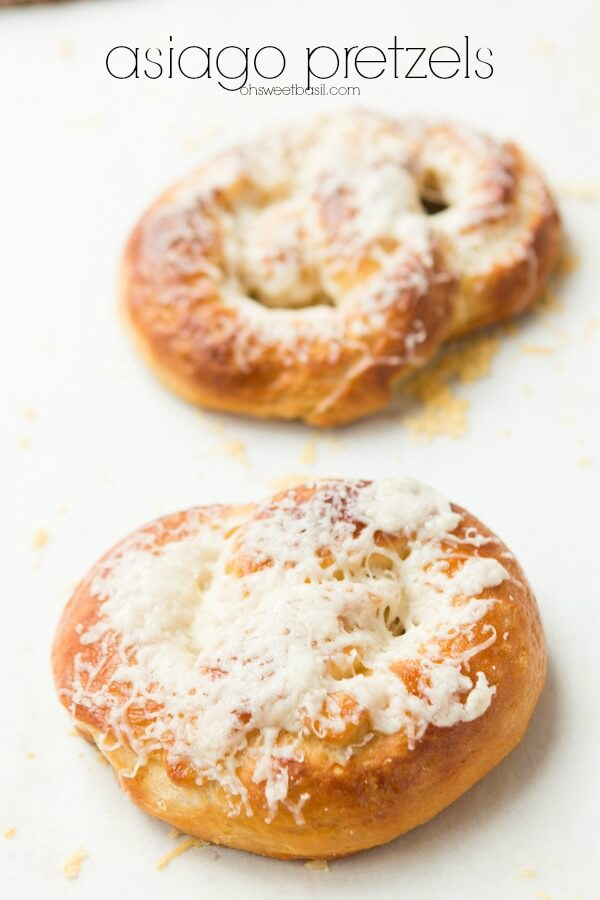 Sometimes there's nothing like hot, cheesy asiago pretzels and a lazy night at home. Or to serve up warm for a holiday or game day party appetizer. ohsweetbasil.com