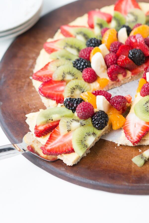 Mom's famous fruit pizza with oat cookie crust! ohsweetbasil.com