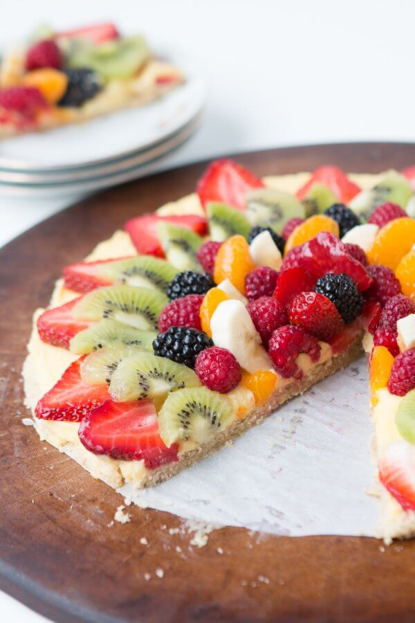 Fruit pizza with oat crust and a creamy topping ohsweetbasil.com