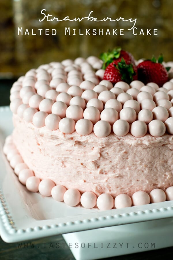 Turn a boxed cake mix into a special Strawberry Malted Milkshake Cake. Homemade strawberry buttercream frosts the inside and out of this vanilla malted milk cake. Decorate quickly and easily with Strawberry Whoppers!