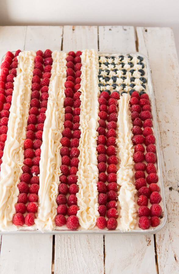Easy white cake, berries and two kinds of delicious frostings for the best flag cake around ohsweetbasil.com
