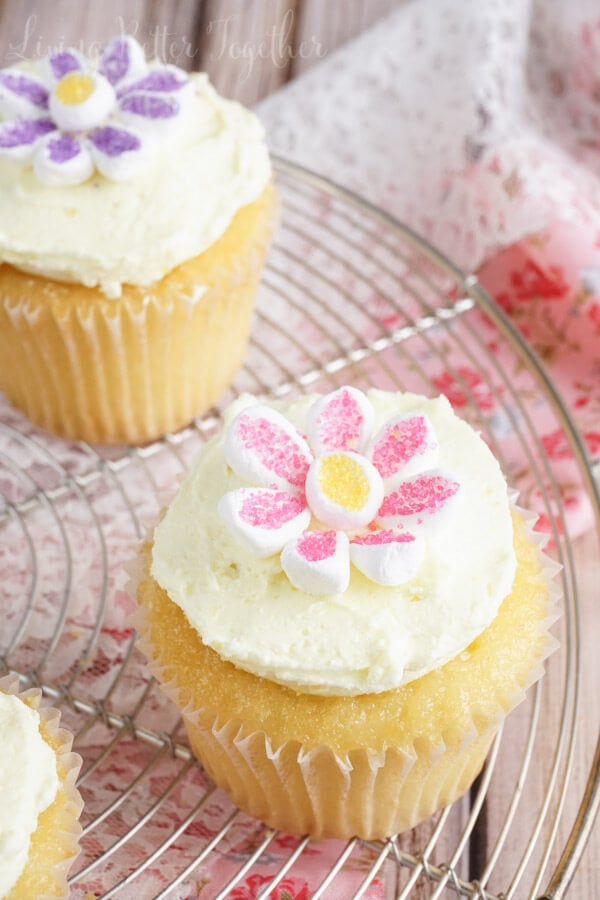 These May Flowers Lemon Cupcakes are as sweet and simple as it gets. Made with just 5-ingredients and topped with adorable marshmallow flowers, they're perfect for Mother's Day and other spring occasions.