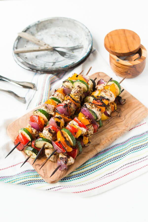 These Tuscan grilled chicken kabobs are so easy and we eat them all summer long. Bright, fresh colors and fresh flavors for dinner tonight! Low-carb, gluten-free, grain-free