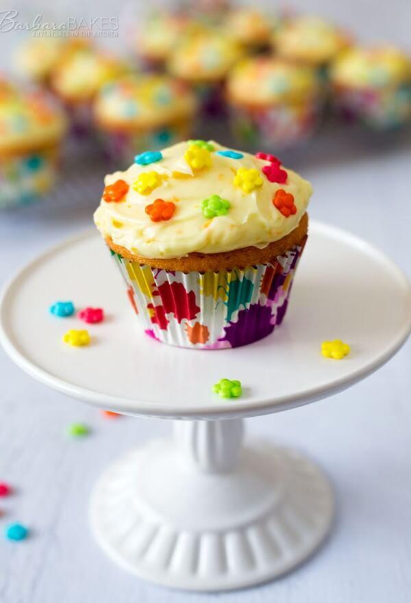 Orange Creamsicle Cupcakes with an orange soda cupcake.