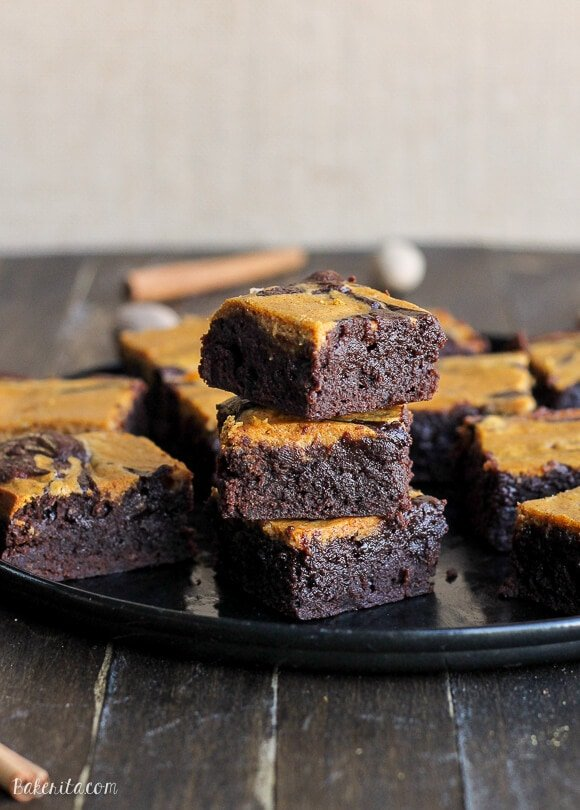These Pumpkin Cheesecake Brownies have a layer of tangy pumpkin cheesecake swirled into rich and fudgy chocolate brownies. This is the best fall dessert recipe!