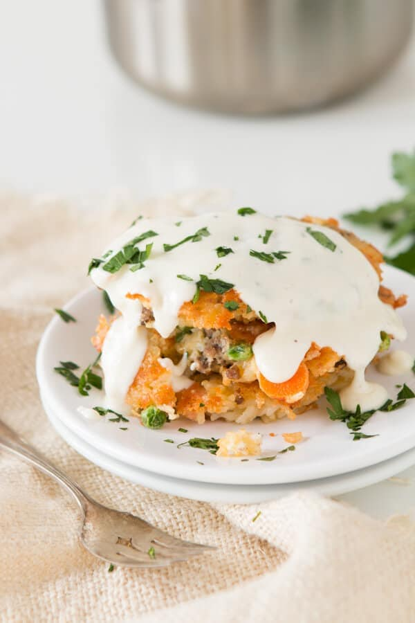 These are so good and just use leftovers! Cheesy ground beef and rice fried cakes with creamy white sauce ohsweetbasil.com