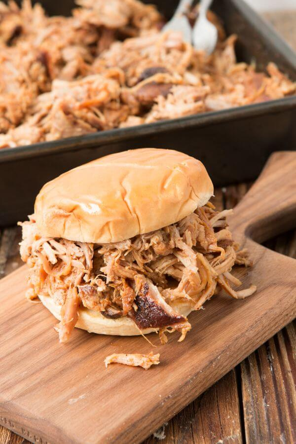 best pulled pork sandwich on wooden serving board
