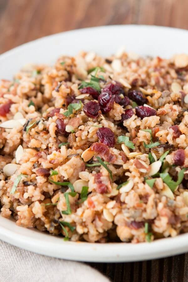 Want something better than plain rice for a side dish? Orange cranberry almond rice pilaf is my new favorite to serve my family especially guests! ohsweetbasil.com