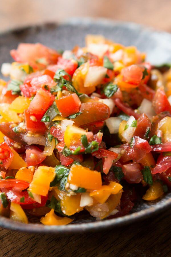 Our absolute favorite fresh homemade salsa recipe ohsweetbasil.com Mexican, cilantro, paleo, whole 30, gluten-free, dairy-free