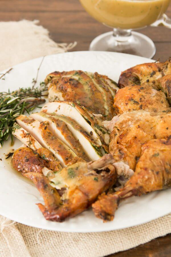 Herb Roasted Chicken starts with a brine and an herb rub down ohsweetbasil.com