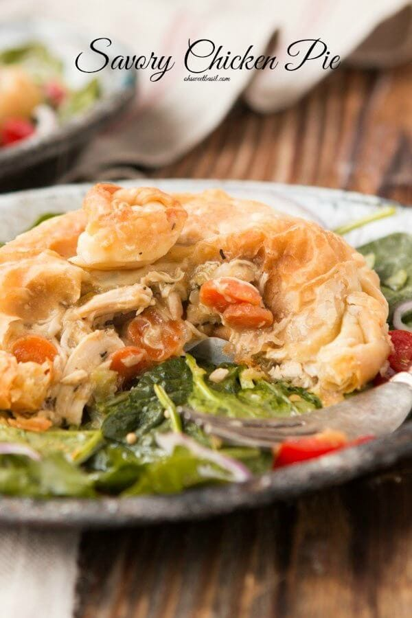 Savory Chicken Pie recipe. It's like your mom's only wrapped in a buttery puff pastry crust ohsweetbasil.com