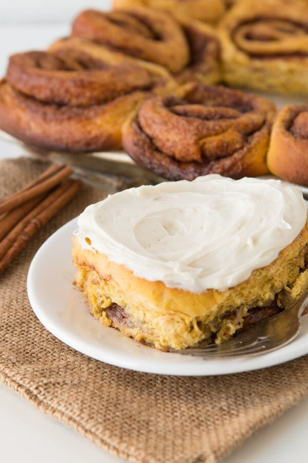 Soft pumpkin cinnamon rolls with thick cream cheese frosting ohsweetbasil.com