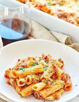 This Spicy Sausage Rigatoni is a simple, hearty, cozy fall dinner! It's made with rigatoni, a homemade spicy sausage marinara, and smothered in mozzarella! ohsweetbasil.com #pasta #sausage