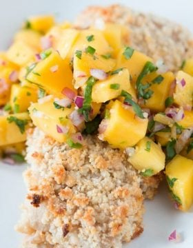 Our favorite way to enjoy mahi mahi with with this coconut marinade, macadamia crust and mango salsa! ohsweetbasil.com