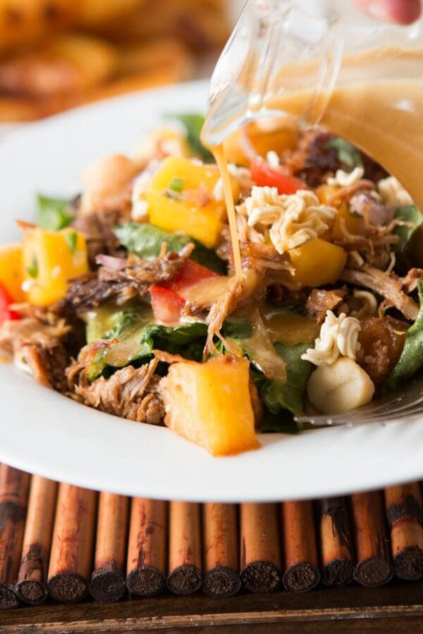 It's everything we love in one big crunchy polynesian pork salad. Hello mango salsa, grilled pineapple and the yummiest poly dressing ever! ohsweetbasil.com
