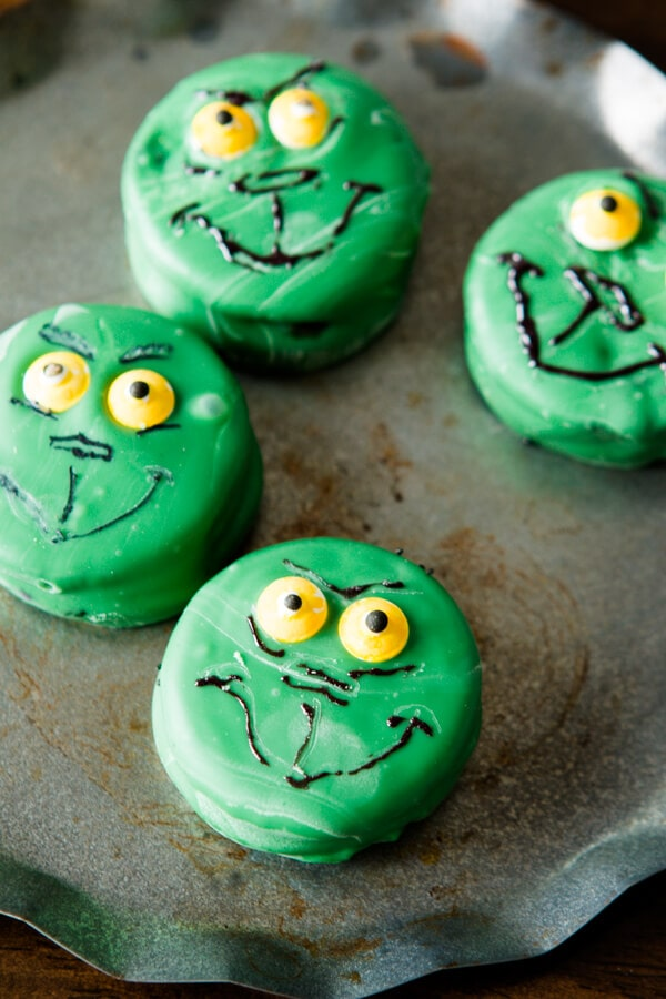 The kids love eating these adorable grinch oreos or santa oreos and moms and dads love that it's a quick and easy activity for the long winter break!