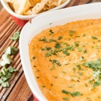 Cheesy Chicken Tortilla Dip is our new guilty pleasure. Can't stop eating it!! ohsweetbasil.com