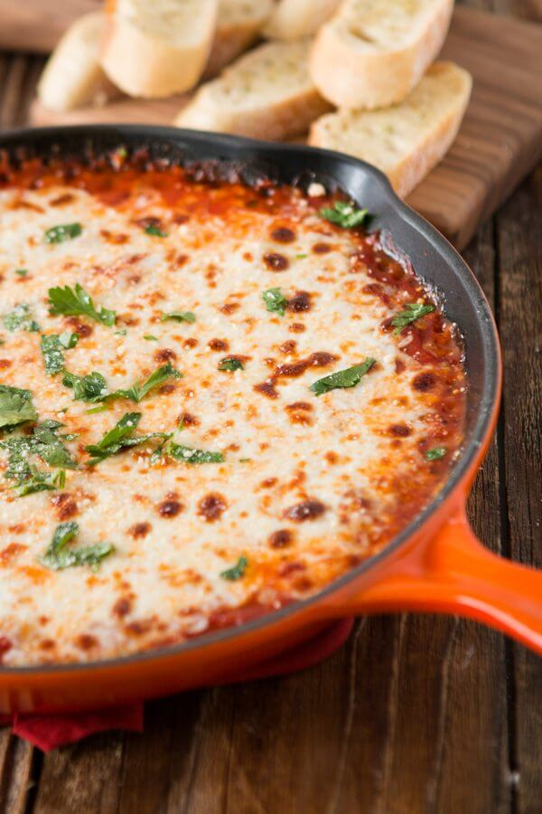 I love dipping garlic bread in the sauce that oozes out of lasagna so why not skip the noodles and turn the whole thing into a cheesy lasagna dip!