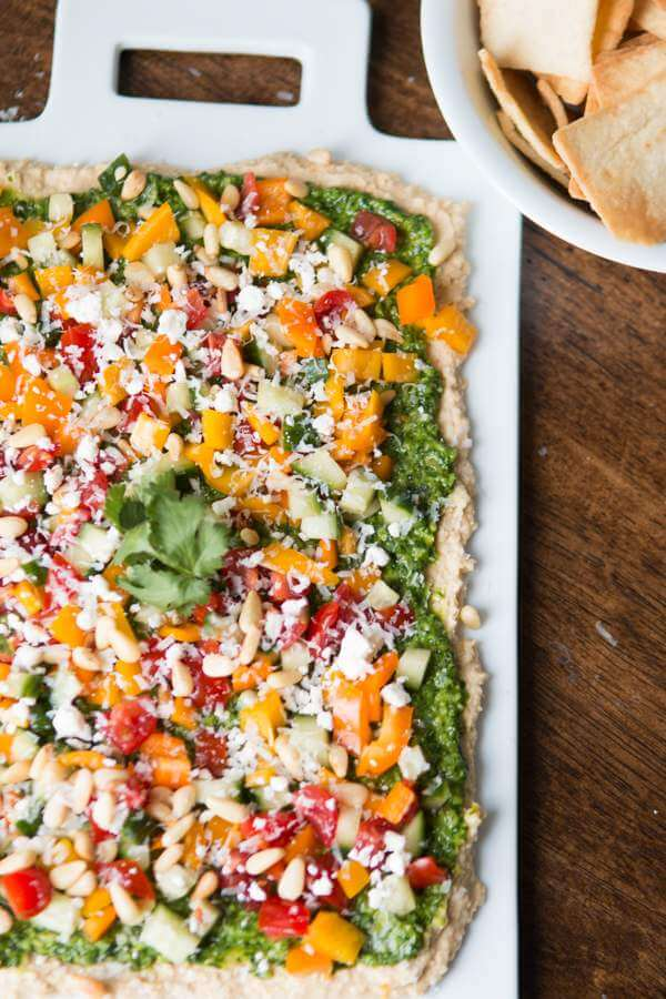 8 layer hummus dip with cilantro pesto ohsweetbasil.com