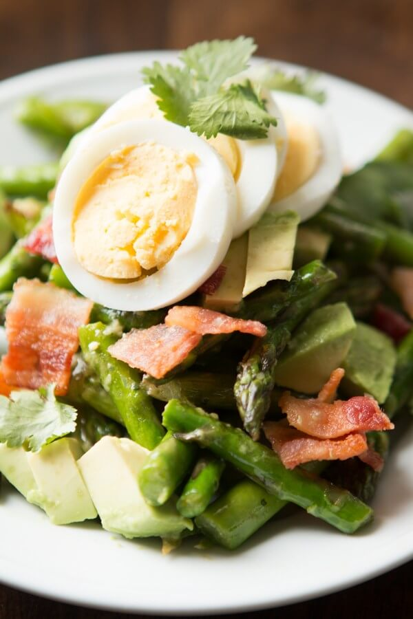 This salad is so good! Asparagus, egg, bacon and avocado with a yummy dressing! ohsweetbasil.com