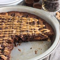 This fudgy peanut butter brownie cake recipe is a fun take on brownies! Full of chocolate and peanut butter flavor, this dessert feeds a crowd.