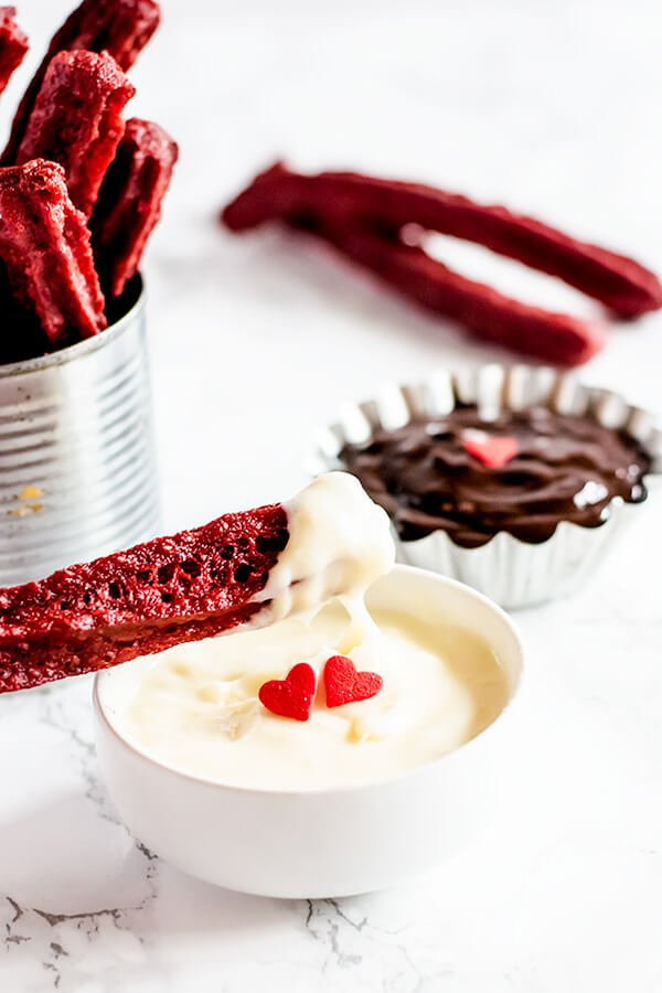 Red Velvet Churros in an aluminum can with a Nutella dip and cream cheese frosting dip.