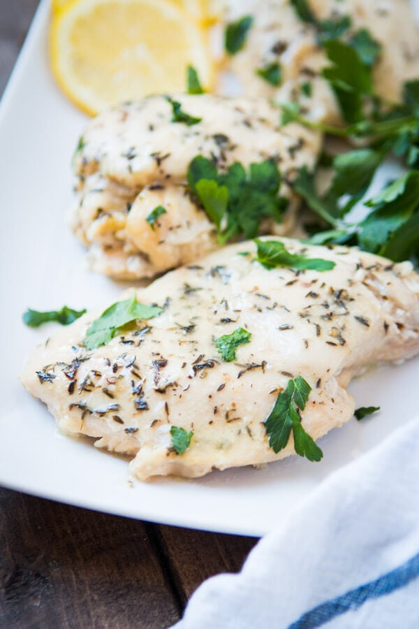 Need a simple summer dinner recipe? Us too and this simple slow cooker lemon butter chicken totally hit the spot the other night.