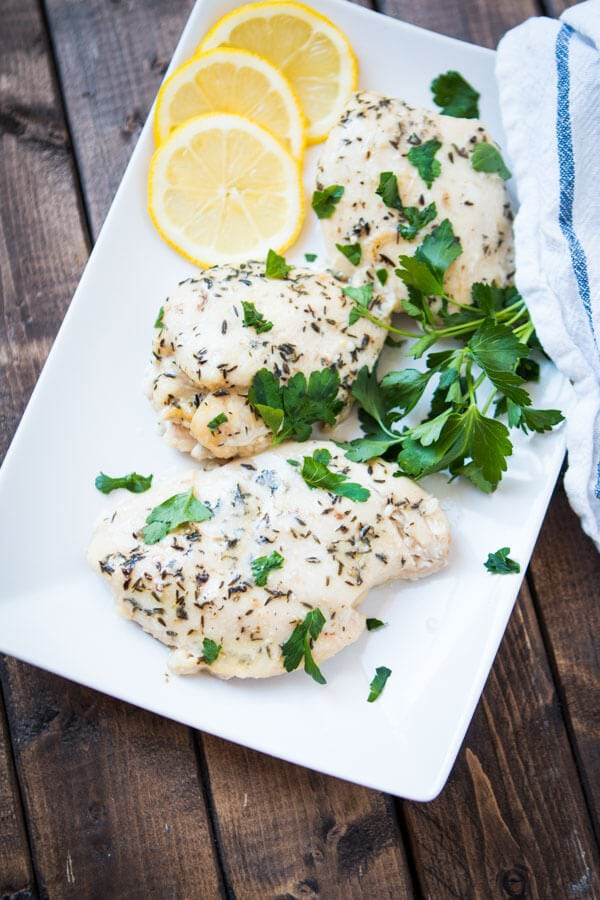 Need a simple summer dinner recipe? Us too and this simple slow cooker lemon butter chicken totally hit the spot the other night. Whole 30, paleo, gluten-free,