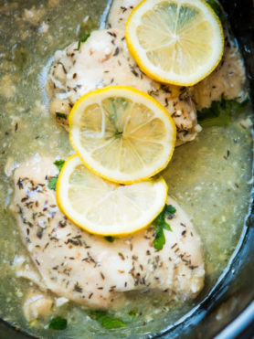 Need a simple summer dinner recipe? Us too and this simple slow cooker lemon butter chicken totally hit the spot the other night. ohsweetbasil.com